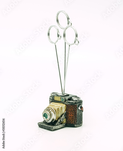 Holder for photos in a camera.