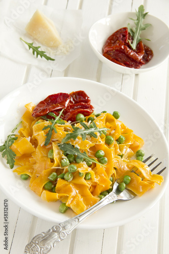 Pumpkin pasta with tomato and basil.