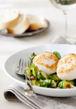 seared scallops with roasted Brussels sprouts and nuts.