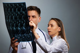 Medical doctors team with MRI spinal scan