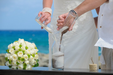 Bride and groom doing sand ceremony