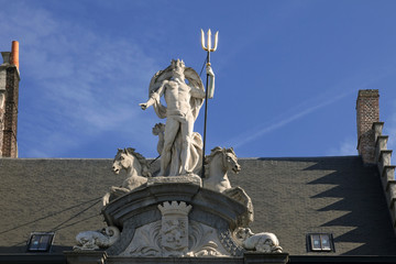 Neptune statue on the house