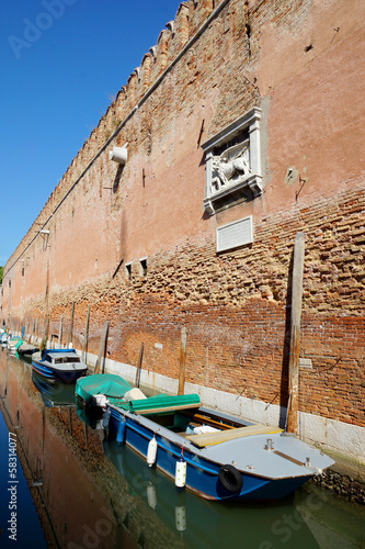 Old brick wall and motor boats. Venice, Italy, Europe