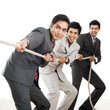 Three Businessmen playing tug-of-war