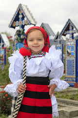 Little girl wearing romanian traditional clothing