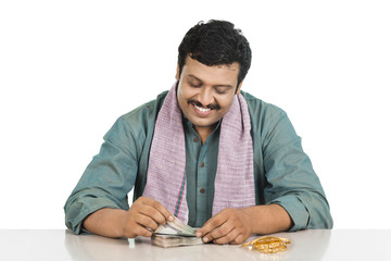 Smiling man counting money