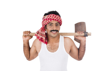 Portrait of a farmer carrying spade on his shoulders