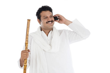 Man talking on a mobile phone and smiling
