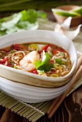 Thai noodle soup with shrimp and fresh vegetables