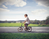 Child Cycling Forward