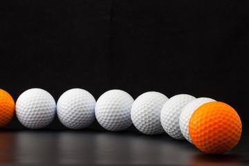 Golf balls on the black background