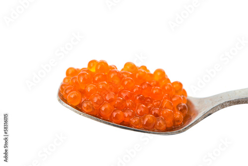 Spoon with red caviar isolated