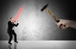 Businessman fighting  with a laser-sword - business challenge