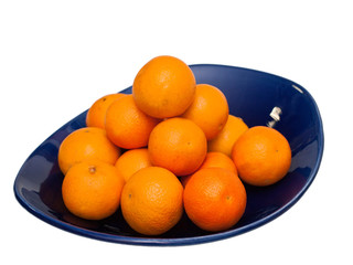 tangerines on blue plate, isolate