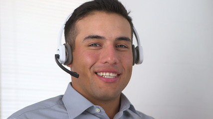 Smiling Latino telemarketer