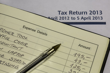 Tax Return form and expense book