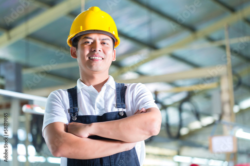 Asian Worker in a factory or industrial plant