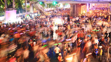 Crowd walking in city (festival), time lapse