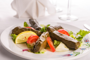 Turkish Style Dolmas Arranged with Tomatoes Lemon and Lettuce
