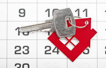 A house key on a calendar background