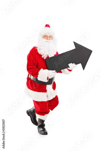 Smiling Santa Claus holding a big black arrow