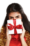 woman with gift isolated on christmas decorated background