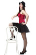 showgirl woman dancing in red corset chair white isolated