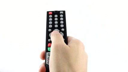 hand pressing on the remote control