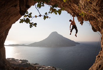 Rock climber at sunset. Kalymnos Island, Greece.