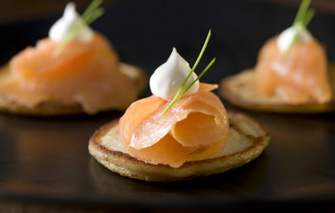 three smoked salmon and creme fraiche appetizers