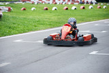 Little karting racer on the track