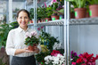 Female florist with Cyclamen plant