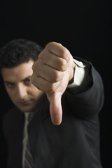 Businessman showing thumbs down sign