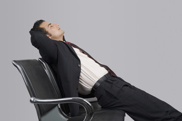 Businessman relaxing on a chair