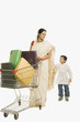 Woman and her son with a shopping cart