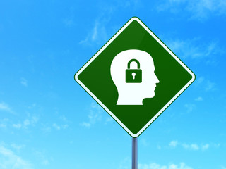 Business concept: Head With Padlock on road sign background