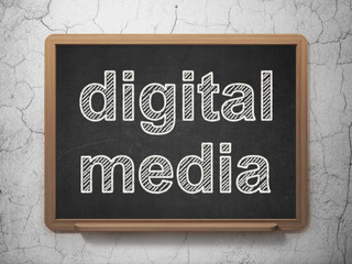 Marketing concept: Digital Media on chalkboard background