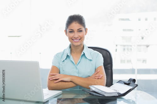 Elegant businesswoman with laptop in office