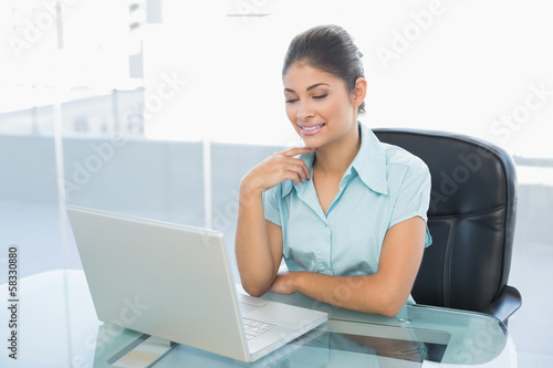 Relaxed businesswoman with eyes closed using laptop