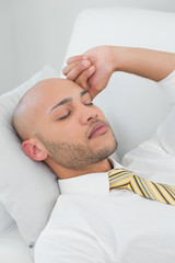 Businessman sleeping on sofa at home