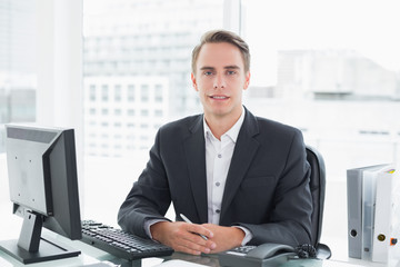 Businessman in front of computer at office desk