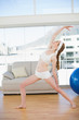 Sporty woman stretching hand in fitness center