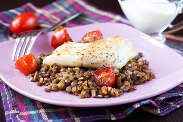 White fish fillet of perch, cod with vegetables, lentils, tomato