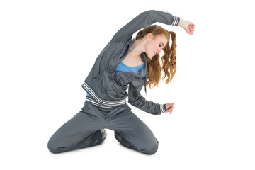 Young woman in sportswear stretching