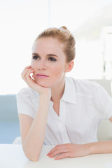 Thoughtful businesswoman looking away at office