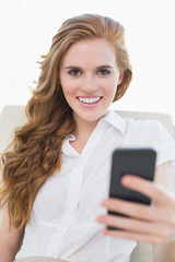 Portrait of a smiling businesswoman with cellphone