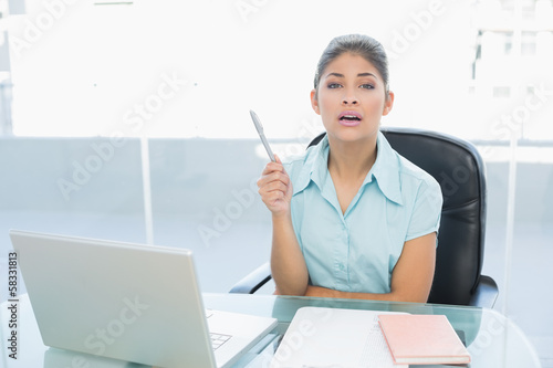Elegant businesswoman with laptop at office