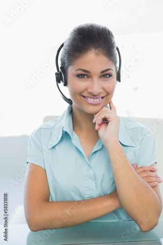 Close up portrait of businesswoman wearing headset