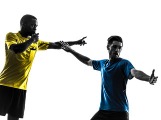 two men soccer player and referee standing silhouette