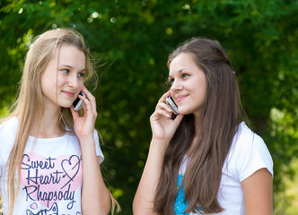 Teen girls talking on cell phone